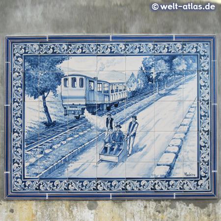 Azulejos in Monte – Kachelbildmotiv mit Zug und Korbschlitten