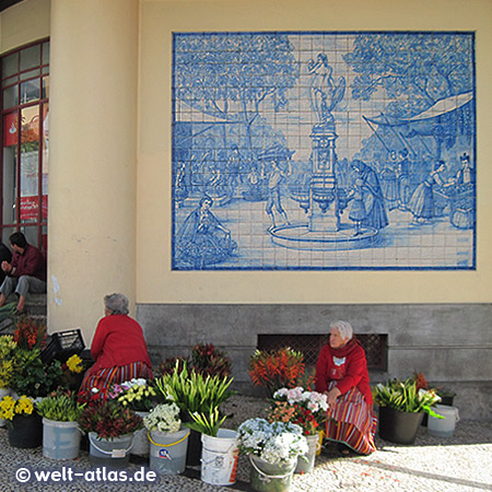 Flower women in their traditional costume in front of the market hall of Funchal