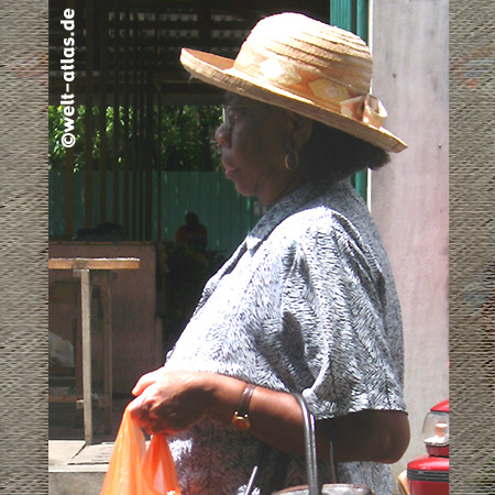 Lady coming from market, Victoria, Mahé, Seychelles