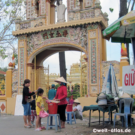 Gate to Buddhist temple with colonial facade, the Vinh Trang Pagoda, My Tho