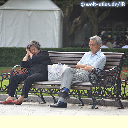 Couple resting on a bench