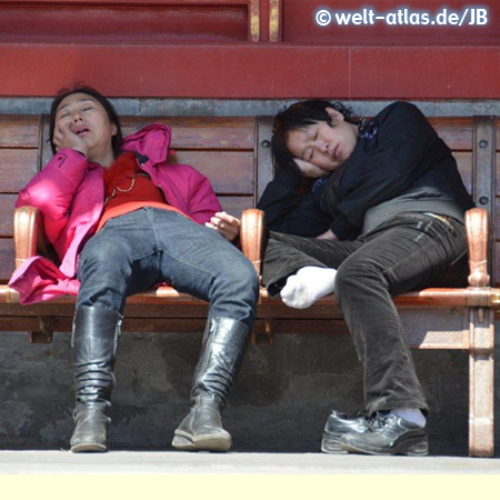 two tired young woman