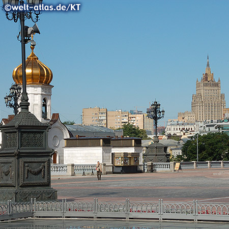 View from the square in front of the Christ the Savior Cathedral, chapel and beautiful old lanterns over to the high-rise building of the Foreign Ministry (Stalinist skyscrapers)