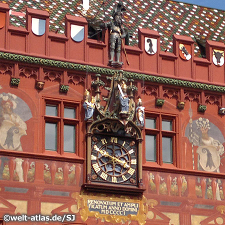 Clock at the City Hall with wall paintings, Basel, Switzerland