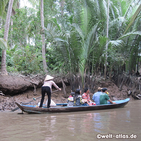 Boat in the labyrinth of islands in the Mekong Delta near My Tho