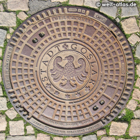 Manhole cover in the city of Goslar with the heraldic eagle