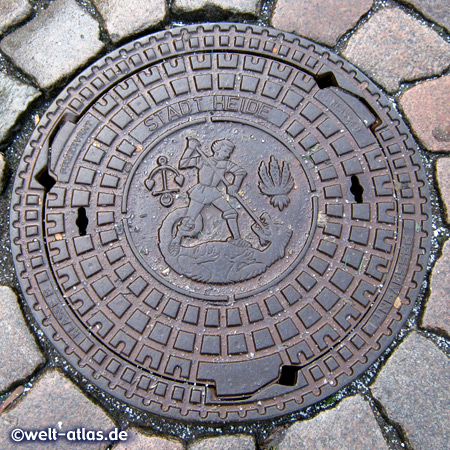 Manhole Cover with the Coat of Arms (St. Jürgen or Saint George) of Heide in Dithmarschen, Germany