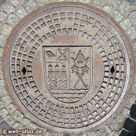 manhole cover with coat of arms in Kolobrzeg, Poland