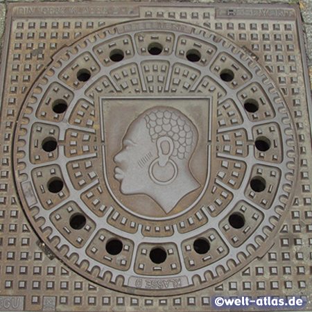 Manhole cover with Coburg Mohr, St. Mauritius in the Coats of arms  of the City of Coburg in Franconia
