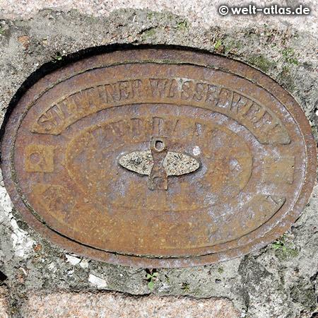 """Old manhole cover """"Stettiner Wasserwerk"""" in Szczecin, Poland"""