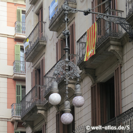 Ornate old lamps and lanterns at many facades of Barcelona