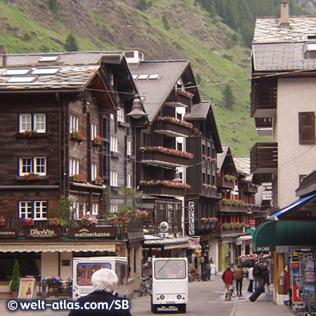 Typical houses and electric cars in Zermatt
