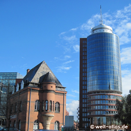 Traditional and modern architecture meet in the warehouse district and the HafenCity, here the old guard house at the port police at Kehrwiederspitze and the new Columbus Haus