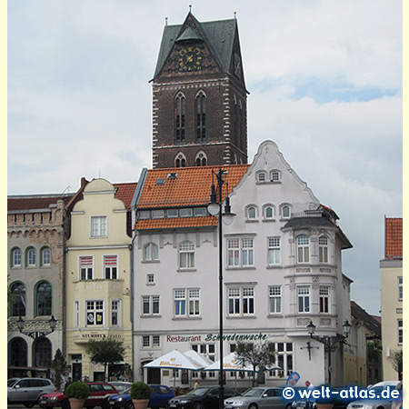 Old houses and tower of church of St Mary, Wismar market square