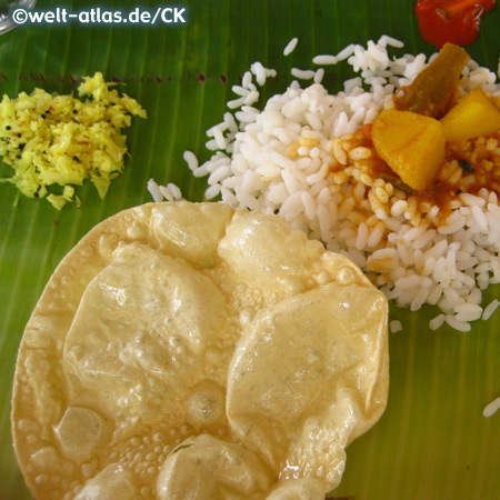 south indian meal with papadams, served on a banana leaf