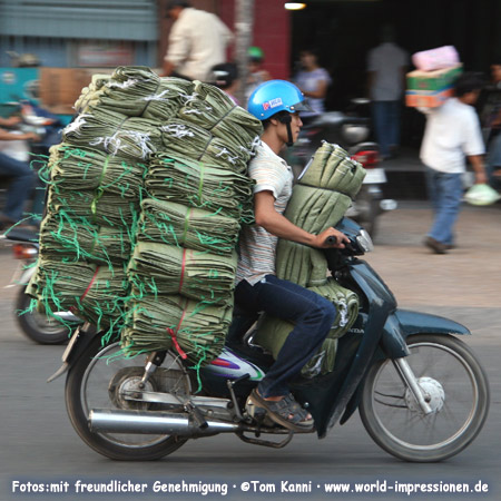 man with his motor bike, carrying goods