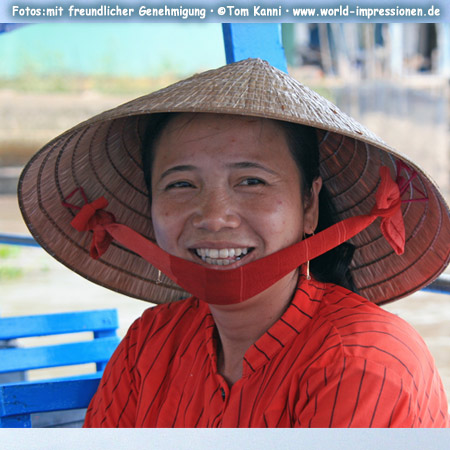 Woman wit a straw hat Mekong-Delta