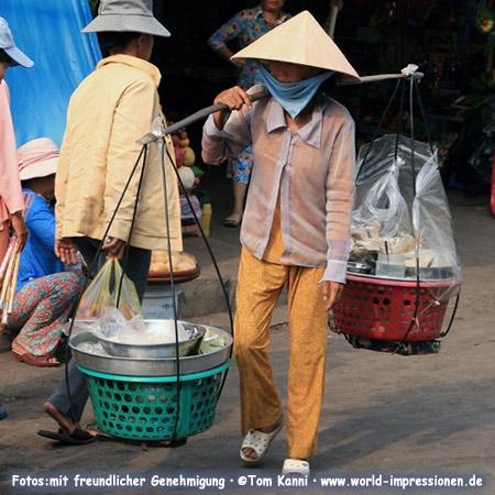 street vendor woman with her kitchen, Vietnam