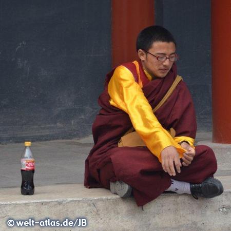 Buddhist monk sitting at Lama Temple, Beijing