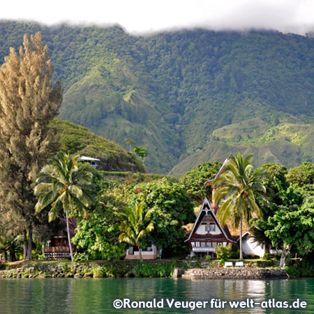 The cozy village of Tuk Tuk on Samosir Island in Lake Toba (Danau Toba) in Sumatra - the lake is the largest volcanic crater lake of the earth with spectacular scenery