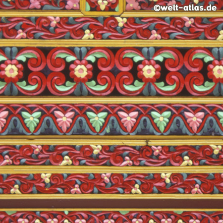 Detail of colored wood carvings on a Minangkabau home near Padang