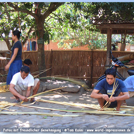 some people are weaving palm fronds, Bali