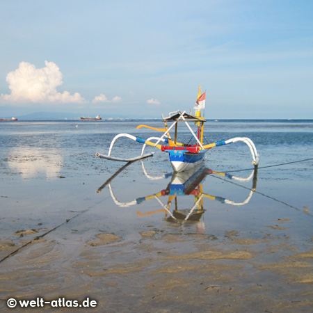 Outrigger boat at low tide at the beach of Tanjung Benoa, Bali