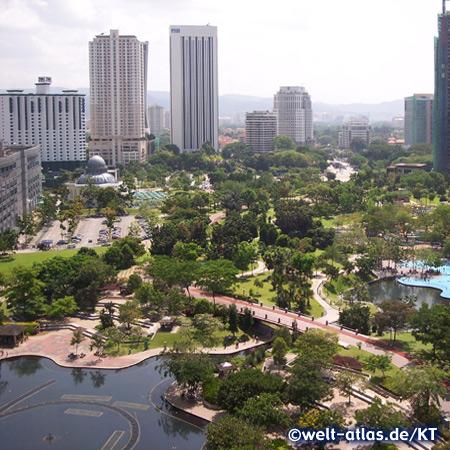 Kuala Lumpur City Center Park with  Asy-Syakirin Mosque